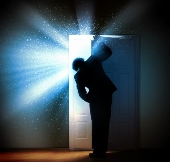 man-opening-door-to-bright-light.jpg